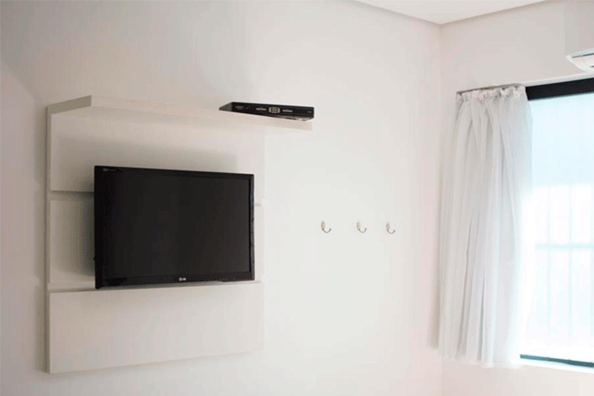 Televisão no Quarto Hostel
